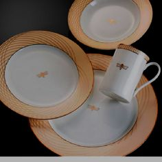 Beautiful dishes I am working for! Bumble bee 50th anniversary Mary Kay collection.