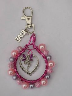 I love fairies keyring.   Can be made in any colour you wish. Only £6.50 each. I ship all over the world. Just pop me a message.   https://www.facebook.com/Theshinyzone