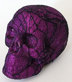 Add a creepy touch to your Halloween decor with our glittered 8-inch foam skulls with black spiderweb lace overlays