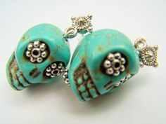 I designed these earrings with carved turquoise magnesite stone skulls. I added beads in their eyes so they look a little crazy and I dangled them