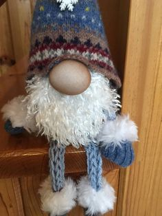 "Gnome made from repurposed wool sweater. Body poly filled and weighed with rice and legs and arms hand knitted into I-cord. Sits approximately 10"" high."