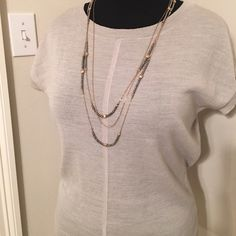 Gorgeous Knit Top Sand colored knit top with knit seam detail down front. Lightweight and airy for spring and summer. Sized XL fits 14-18. Perfect for work or dressing up jeans! All you need is a little sparkle! Ships in 24 hrs! Bundle for discounts! The Limited Tops
