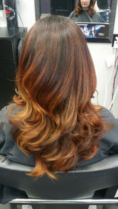A red to copper to peach balayage Hair By Lisa