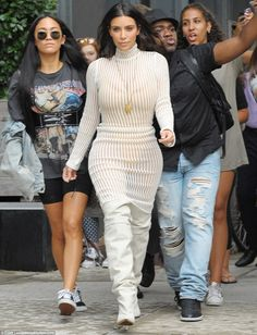 Sheer daring: Kim's very high-cut gold bodysuit could be seen underneath the…