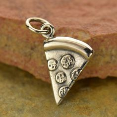 A personal favorite from my Etsy shop https://www.etsy.com/listing/427870857/sterling-silver-pizza-charm