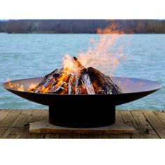 The Asia outdoor fire pit is one of several contemporary styles that we offer from designer Rick Wittrig. They are very high quality, hand produced and will provide years of use for either a home owner or commercial setting.Each pit is made of 14'' thick carbon steel and is individually signed and numbered by Wittrig. It has an iron oxide finish on the outside which will darken slightly with time and then become permanent. The interior is coated with a high temperature resistant paint and…
