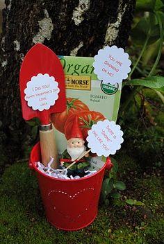 Gift for the garden lover (little statue, gardening book, seeds, tools, gloves, etc.)