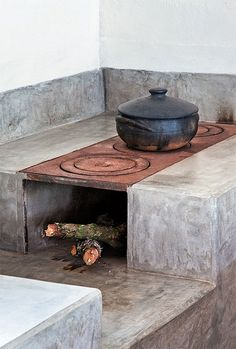 Grey Concrete and a Wood Burning Stove Top....nice!
