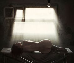 nude girl and light from old window by David Dubnitskiy