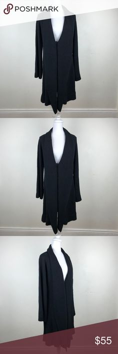 "CAbi long black knit cardigan button closure Large Pristine condition. material: 60% cotton, 40% Acrylic. Single button closure on the front (inside). Waterfall drape front.  measurements: armpit to armpit: 21"" armpit to hem: 30"" total length: 37"" sleeve length: 30.5"" CAbi Sweaters Cardigans"