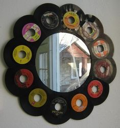 Dont throw those old records away...make a funky mirror!
