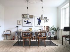 Inspiration for our carved out dining space. (Bookshelf under the window and the table turned). Industrial pendants are great.