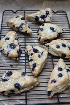 blueberry scones w/ lemon glaze. goodness i love scones. I should do this with my Huckleberries