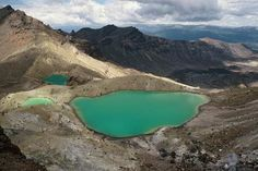 The Emerald Lakes fill explosion craters near the summit of Mt Tongariro, New Zealand. Their brilliant colours are partly caused by dissolved minerals, washed down from the thermal area of nearby Red Crater.