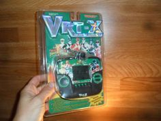 Power+Rangers++vrt-x++3d++Hand+Held++Video+Game................from+1995+ 3d Hand, Video Game Console, Power Rangers, Consoles, Holding Hands, Mickey Mouse, Hold On, Nintendo, Games