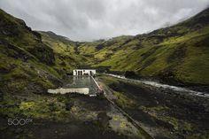 Seljavellir, Iceland - 2015 - The hidden pool of Seljavallalaug close to Skógar, in southern Iceland.