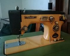 Bling Bling vintage 50's sewing machine made by Toyota. Electro Grand 400 Deluxe in original ART DECO colors peach & deep gray. RARE