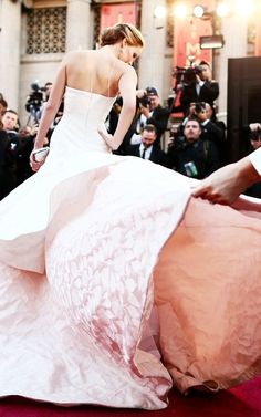 Jennifer Lawrence in Dior. This would make such a gorgeous wedding dress for a tall, slim bride!!!