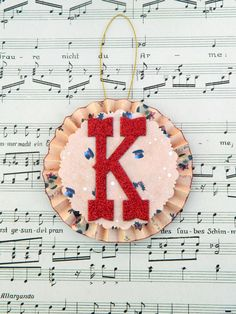 Paper Rosette Christmas Decoration, Initial K, Red Cream and Blue - pinned by pin4etsy.com