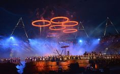 Risen: freshly forged Olympic rings rise into the air  Picture: AFP