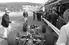 CHIEF - Colin Chapman is pointing something out for a marshall during ...