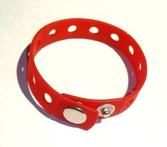 """8"""" Red Rubber Bracelet Wristband for Shoe Jibbitz Crocs Charms by Hermes. $6.49. Includes 1 Rubber bracelet wristband - red color (crocs charms pictured are not included). Two snap closures. Length: 8"""". Width: 0.75"""". Great Gift 0r Give as Party Favors. More Colors Available in Our Store: Pink, Purple, Blue, Pink e t.c.. Press the holder of the Charms with a slight twist in the holes of the bracelet."""