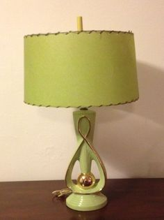 This gorgeous mid century ceramic lamp with green fiberglass shade just reaches out and grabs me!
