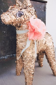 Cinco de Mayo—Gold donkey piñata. Spray painted gold.  Flowers are made from coffee filters colored with Rit Dye and mixed colors to create a beautiful coral color.