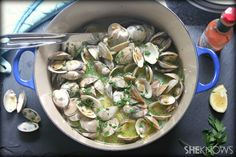 Steamed clams with a white wine butter sauce recipe.  Tip: use butter to sauté shallots and garlic instead of pouring over at the end.