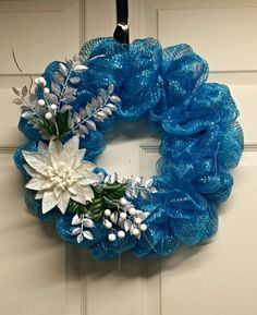 Items similar to Winter Blue Deco Mesh Winter Wreath with Poinsetta - Blue Christmas Wreath - Winter Wreath - Deco Mesh Wreath - Poinsetta Wreath on Etsy Blue Poinsetta Mesh Wreath. Check out this item in my Etsy shop… Christmas Mesh Wreaths, Christmas Crafts, Christmas Decorations, Winter Wreaths, Christmas Mantles, Autumn Crafts, Christmas Trees, Christmas Ornaments, Deco Mesh Garland