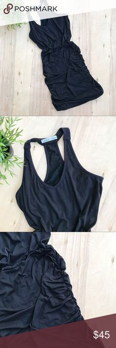 Athleta black cinched racerback dress Black Athleta dress with racerback and cinched sides. Built in bra. Polyester rayon blend. Athleta Dresses Mini