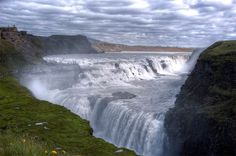 "Gullfoss Falls, Iceland whose name translates as ""Golden Falls\"" in English, might think it empties into an abyss given its unusual drop. The glacier-fed falls, about 70 miles east of Reykjavik, plunge abruptly into a wide and narrow canyon at a perpendicular angle, creating a striking scene."