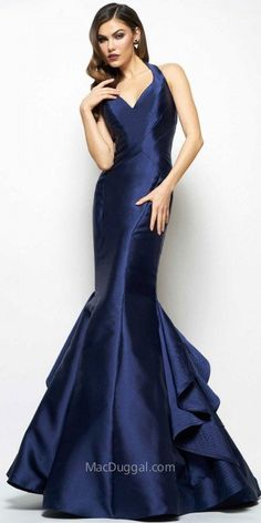 The Keyhole Back Ruffled Taffeta Trumpet Evening Gown by Mac Duggal is a must have dress for your next event! This dress features a structured halter neckline, a sleeveless bodice and a keyhole open back. The trumpet silhouette also includes taffeta fabric, a ruffled flared bottom and a zipper closure. #edressme