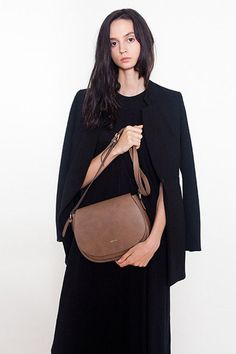 A classic everyday cross-body handbag in soft vegan leather. Each bag gives  back 34ccebc38fa3d