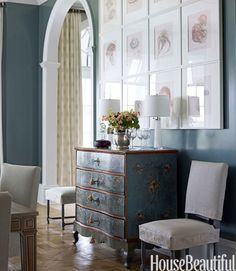 Watson put prints of jellyfish from a book in simple white frames and hung them in a grid above a 1770 Swedish chest in the dining room.