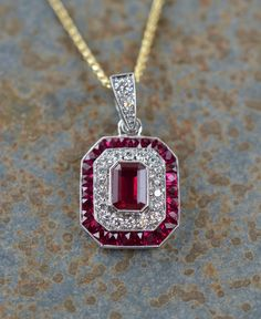 Ohio State University Pendant with rubies and diamonds set in in 14 carat white gold