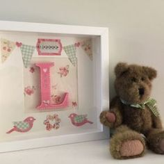 A beautiful vintage styled personalised name box frame. Handmade with gorgeous colours and patterns. Little flowers, birds, bunting and gingham all come together to make a lovely feminine picture. Personalised with a 18mm deep and 10cm tall wooden letter in the centre and the first name spelt in letter beads at the top. A keepsake to treasure for years to come by girls and women alike.
