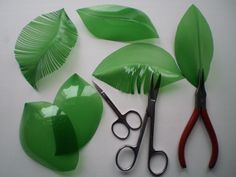 Recycled green plastic bottles cut or burned into leaf shapes – Artofit Plastic Bottle Art, Water Bottle Crafts, Plastic Plastic Bottle Planter, Plastic Bottle Caps, Reuse Plastic Bottles, Plastic Bottle Flowers, Plastic Art, Recycled Bottles, Plastic Canvas, Water Bottle Crafts, Bottle Cap Crafts