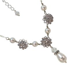 A personal favorite from my Etsy shop https://www.etsy.com/listing/93477936/bridal-necklace-swarovski-crystal