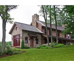 I just love a farmhouse with field stone, but the red accents put this one over the top for me.