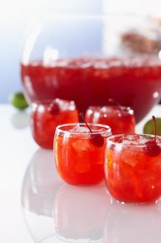 This old-timey rum punch will keep a whole houseful of guests satisfied. Make the Mount Gay Rum Punch for your next party. Christmas Drinks, Holiday Drinks, Summer Drinks, Fun Drinks, Beverages, Holiday Punch, Christmas Punch Alcohol, Simple Vodka Drinks, Halloween Punch Alcohol
