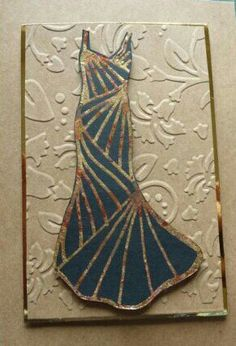 I used a quickie glue pen and applied gilding flakes to the blue dress on this embossed craft card