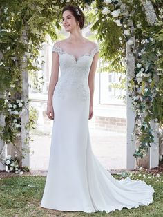 Rebecca Ingram - NAOMI, Soft lace adorns the bodice of this elegant sheath wedding dress, with sheer lace comprising the illusion off-the-shoulder sleeves and accenting the sweetheart neckline and illusion scoop back. Complete with flowing Talin-stretch crepe skirt. Finished with covered buttons over zipper closure.