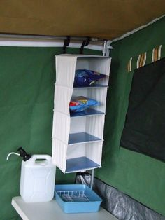 Camping Tips and Tricks Use Collapsible shelves in your Camper Trailer for extra storage!Use Collapsible shelves in your Camper Trailer for extra storage! Diy Camping, Vw Bus Camping, Camping Hacks With Kids, Family Camping, Camping Gear, Outdoor Camping, Camping Stuff, Camping Equipment, Camping Tricks