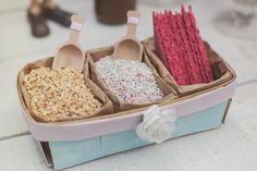 Ice cream party topping displayed in embellished berry baskets.