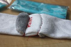 ice pack device from socks ... buy knee-high basic tube socks (...without heels...). Overlap them at the toes and stitch two lines...ice packs will fit in each side of the socks...overlapped section goes at your chin...ends of the socks are tied up over the top of your head...chin will be comfortable and the ice will be held at just the right spots on your cheeks while a thin layer of cloth will protect your skin. I found a 2-inch overlap worked best.