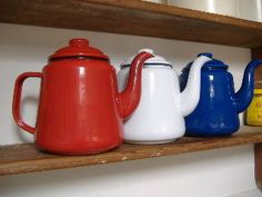 girl's own store, in bridport dorset, vintage and retro style, greengate stockist, kitchenware and classic enamelware, blue and white tableware including jugs and bowls.