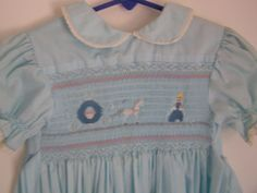 """Cinderella"" Gwen Milner smocking plate set into pale blue broadcloth basic yoke dress"