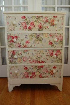 Great way to give a facelift to a damaged or dated piece of furniture! This would be perfect for the new studio.