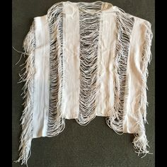 """PILYQ White Fringe Cover Up Boat neck line on seam arm holes. Draping threads connect panels of fabric with some stretch. Fringe sides. 24"""" long x 27"""" wide when laid flat. Very dramatic and very cool. Excellent pre owned condition. Smoke and pet free home. No tears, pulls or stains. PILYQ Swim Coverups"""